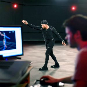 Student works with actor in motion capture studio